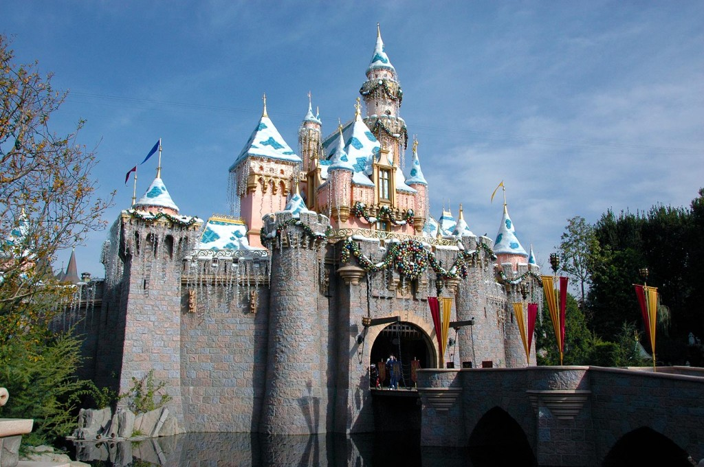 Sleeping Beauty Castle adorned with snow and other seasonal decor is a focal point for Disneyland's holidays.
