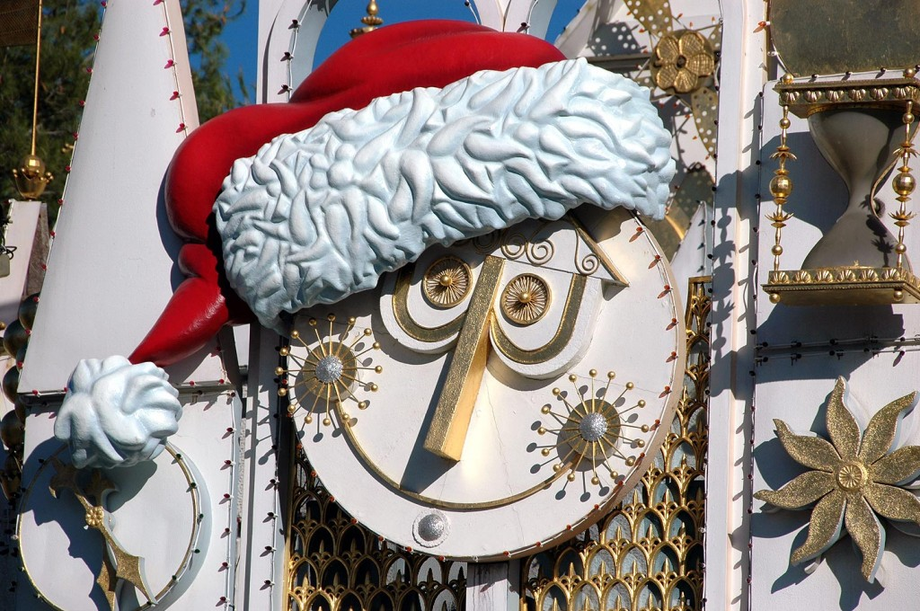 it's a small world gets a holiday makeover every year including a Santa hat on the iconic clock face.