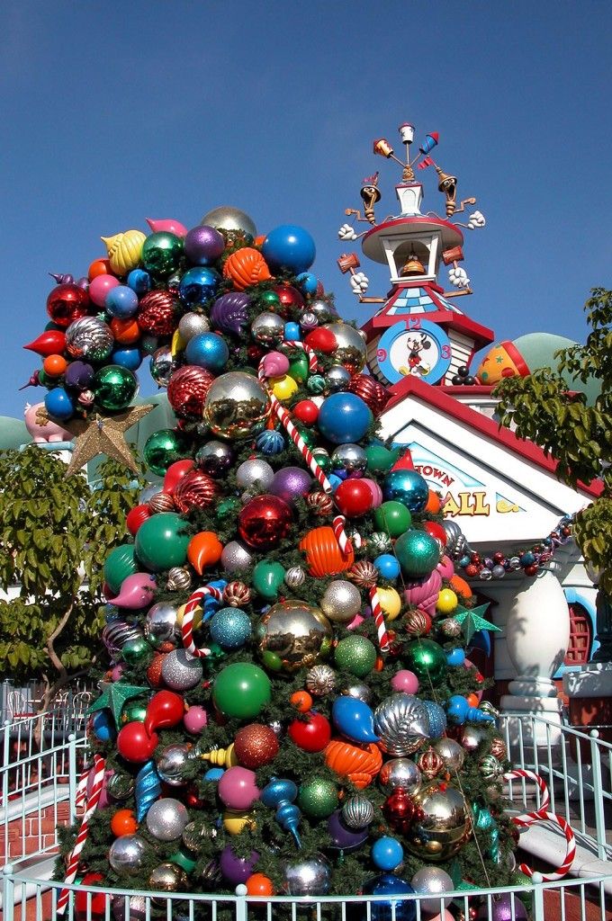 Mickey's Toontown gets a healthy dose of holiday decor in both the residential and downtown areas.  Here a toon tree bends from the weight of an overly heavy tree topper.