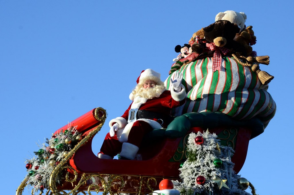 Santa Claus heads up the anchor float of the Christmas Fantasy Parade, complete with plush Mickey and Minnie dolls in his sack of toys.
