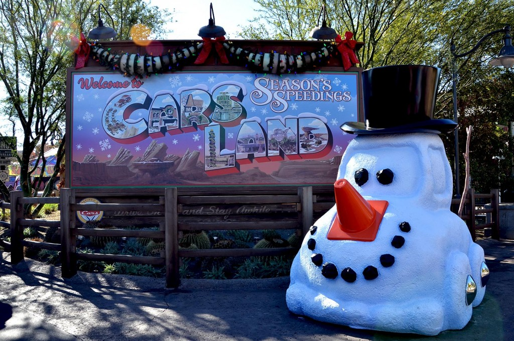 The Welcome to Cars Land signage in front of the new land has been updated to reflect a holiday theme, including a snow car to welcome visitors.